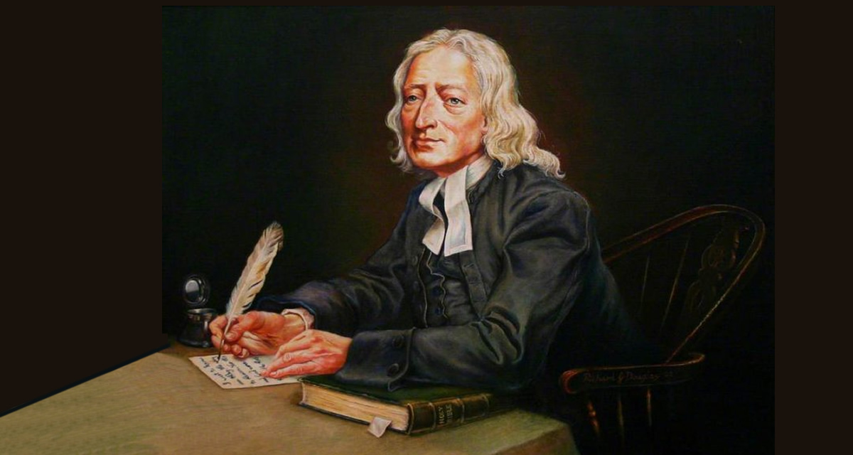 John Wesley writing at a desk with feather pen